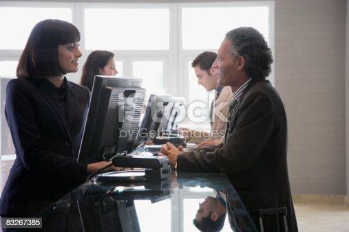 istock Customer service representative helping businessman 83267385