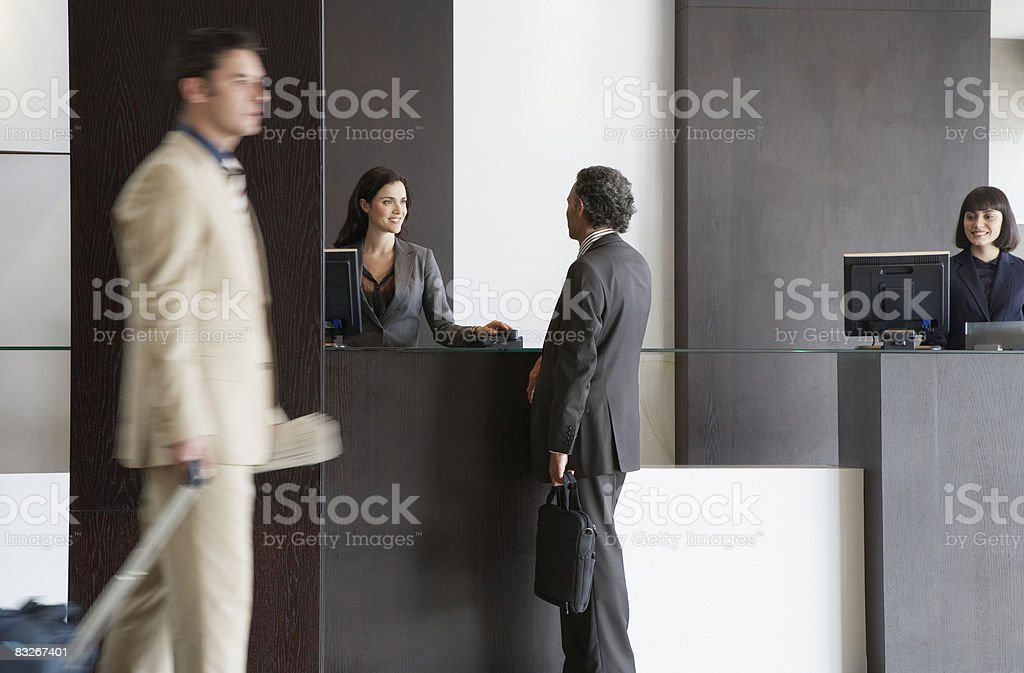 Customer service representative helping businessman stock photo