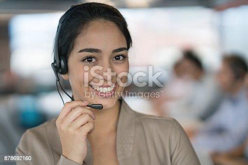 istock Customer service representative working at a call center 878692160