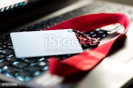 istock Customer service representative's ID badge on computer 670979290