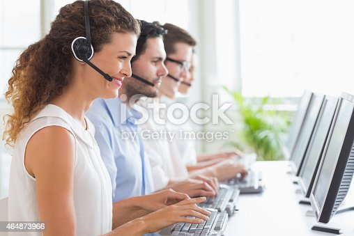 istock Customer service representatives working at desk 464873966