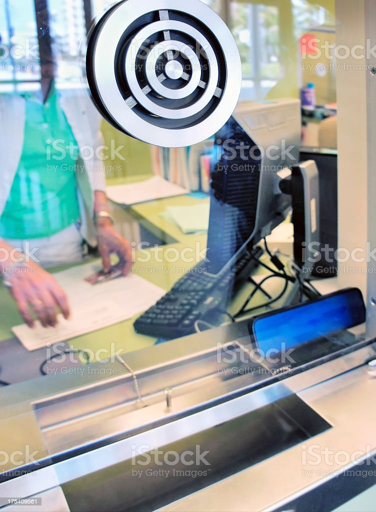 Customer service window with microphone stock photo