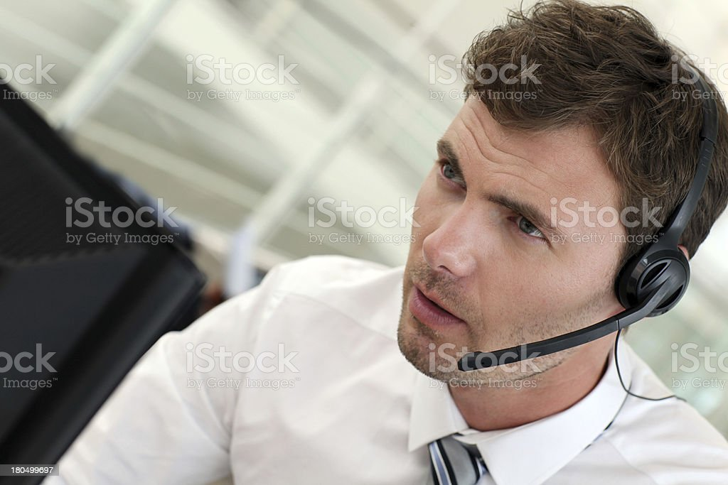 Customer service working with computer and phone stock photo