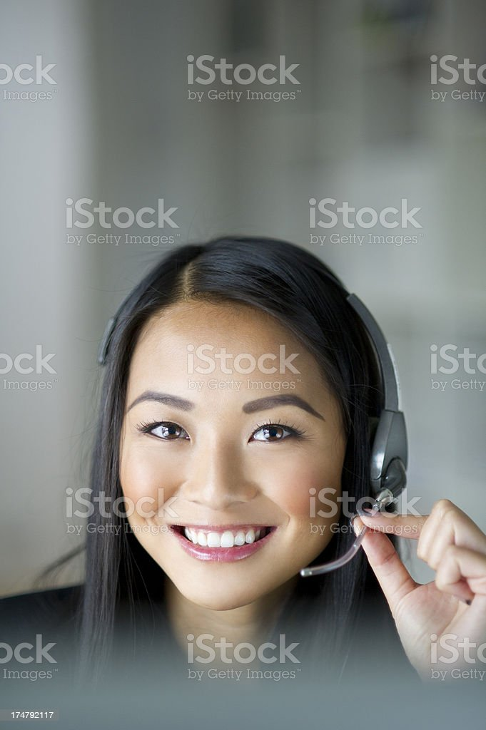 young call centre worker responding to a call