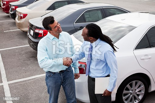 1138561232 istock photo Customer shaking hands with car salesman 185260457