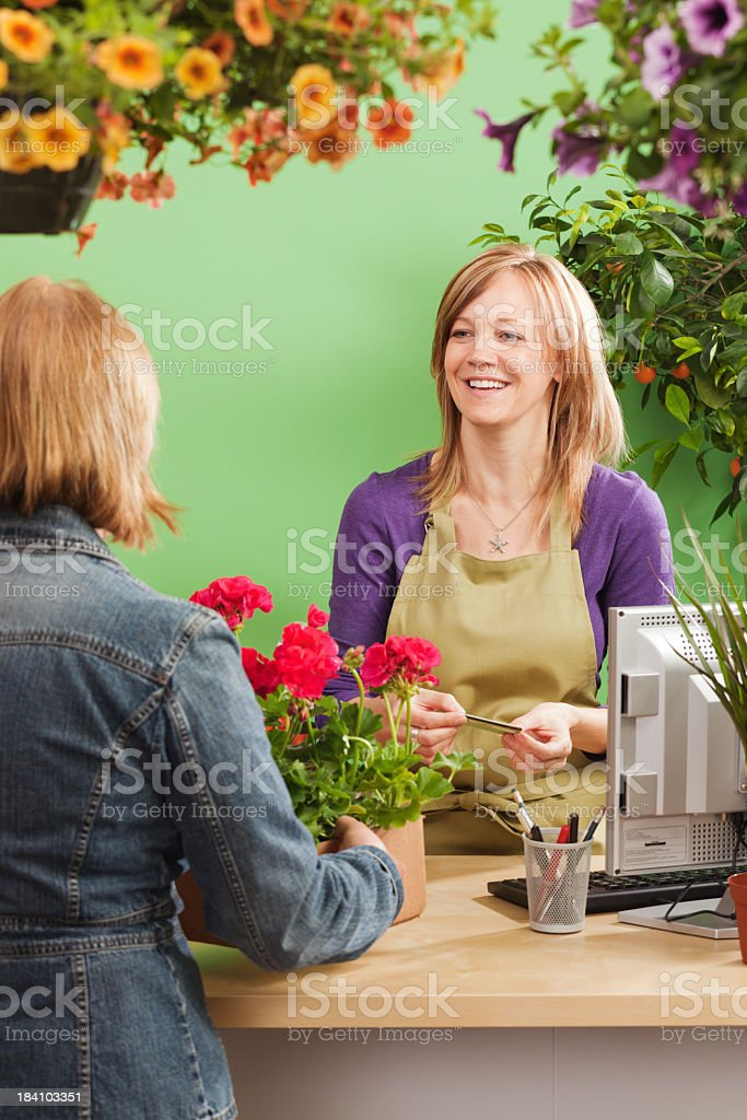 Customer Shopping at Retail Garden Center with Credit Card Vt royalty-free stock photo