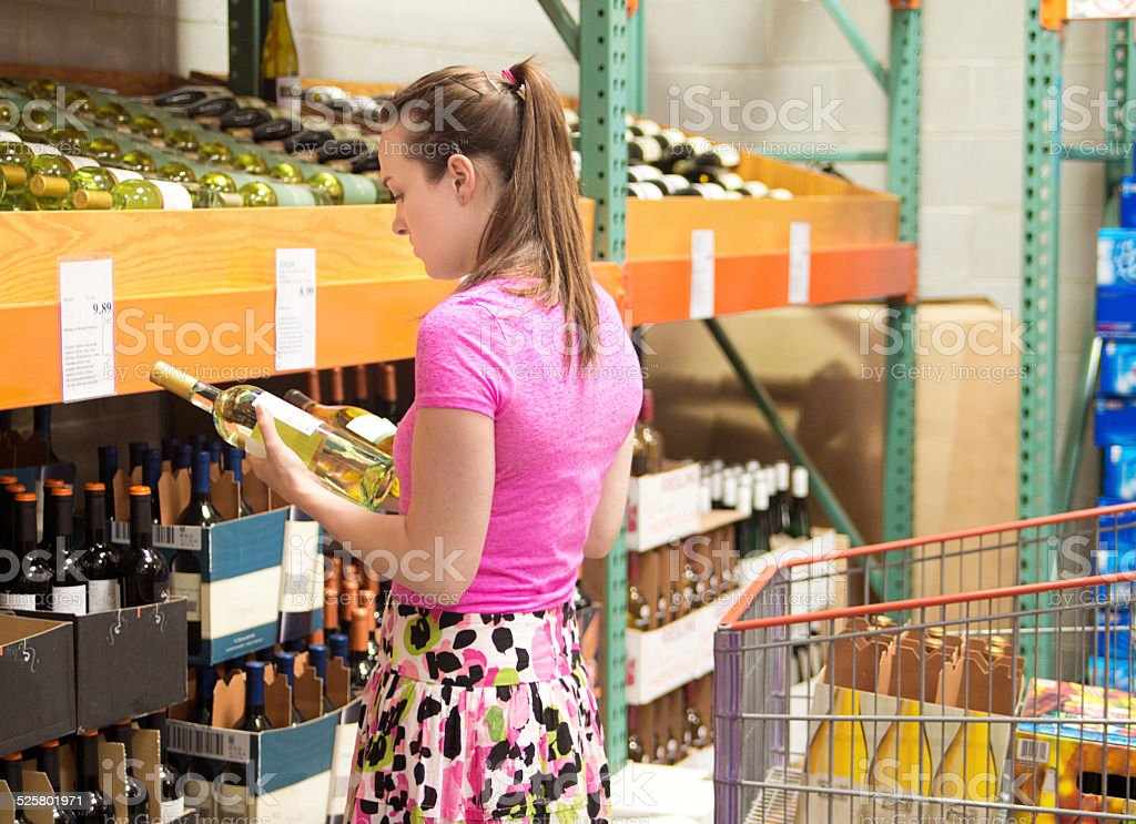 Customer Shopping in Liquor Store Wine Shop stock photo