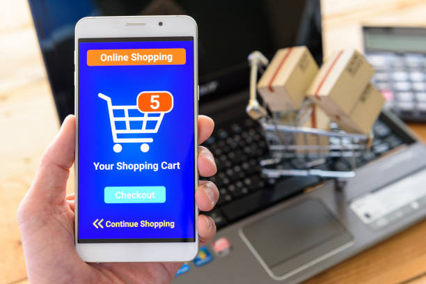 Customer shops online by using online shopping apps. stock photo