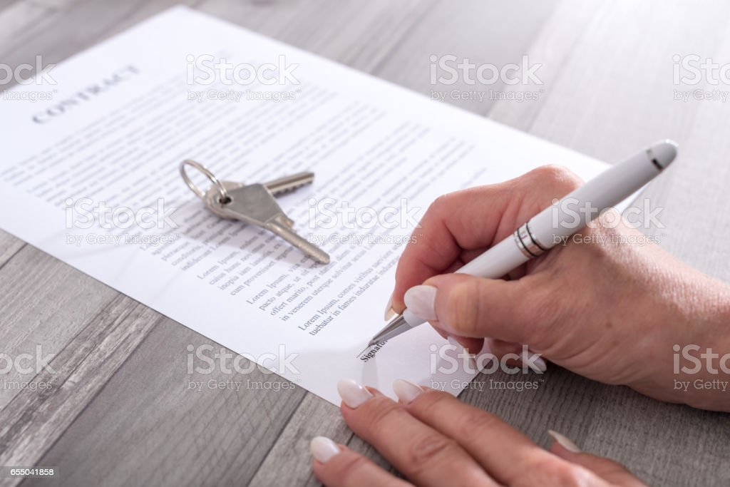 Customer signing a real estate contract stock photo