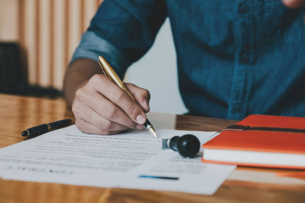 Customer signing contract for reantal or buy home - Real Estate Concept stock photo