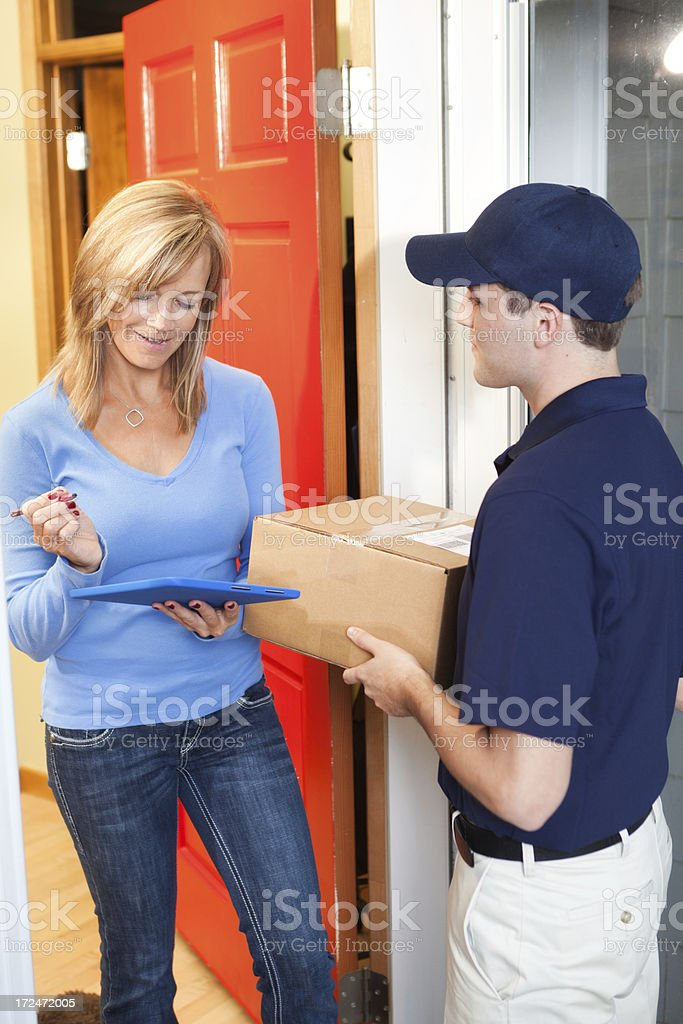 Customer Signing for Package from Residential Home Delivery Man Vt stock photo