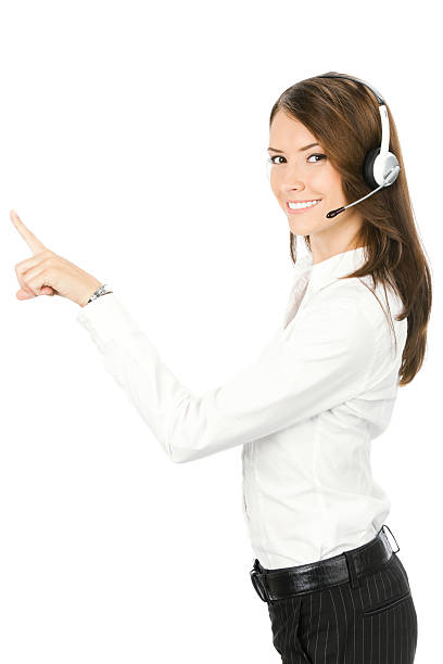 Customer support phone operator in headset pointing at something stock photo