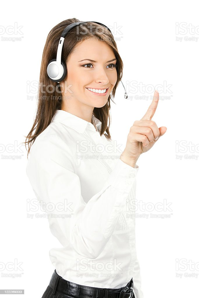Customer support phone operator in headset pointing at something royalty-free stock photo