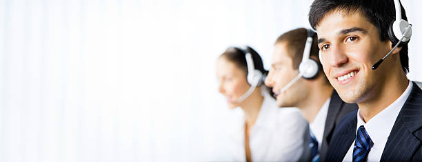Customer support phone operators at workplace stock photo