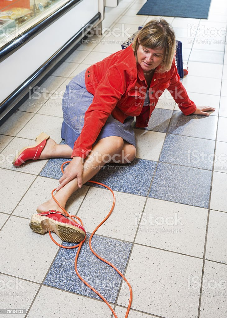 Customer tripped over an electrical cord stock photo