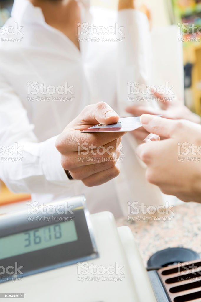 Customer using his credit card to make a payment royalty-free stock photo
