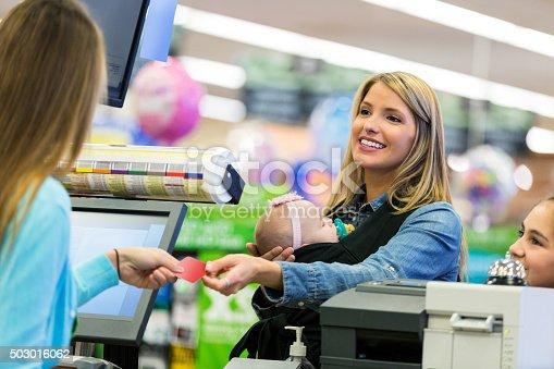 istock Customer using loyalty card or credit card at supermarket 503016062
