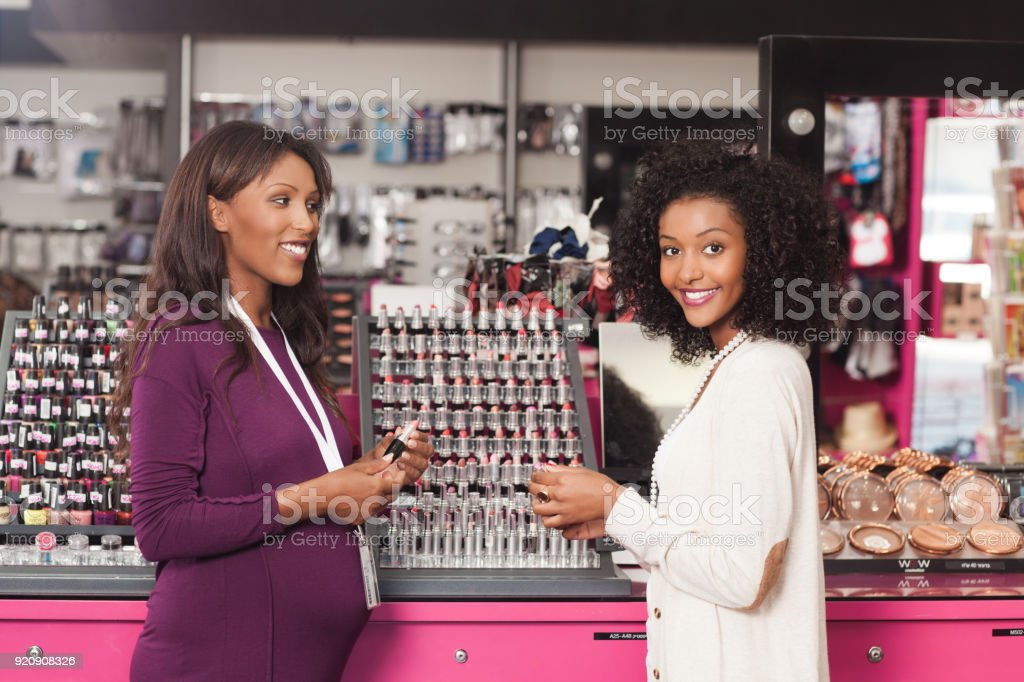 Customer with a beauty consultant. stock photo