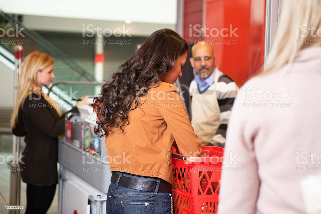 Customer with basket while shopping stock photo