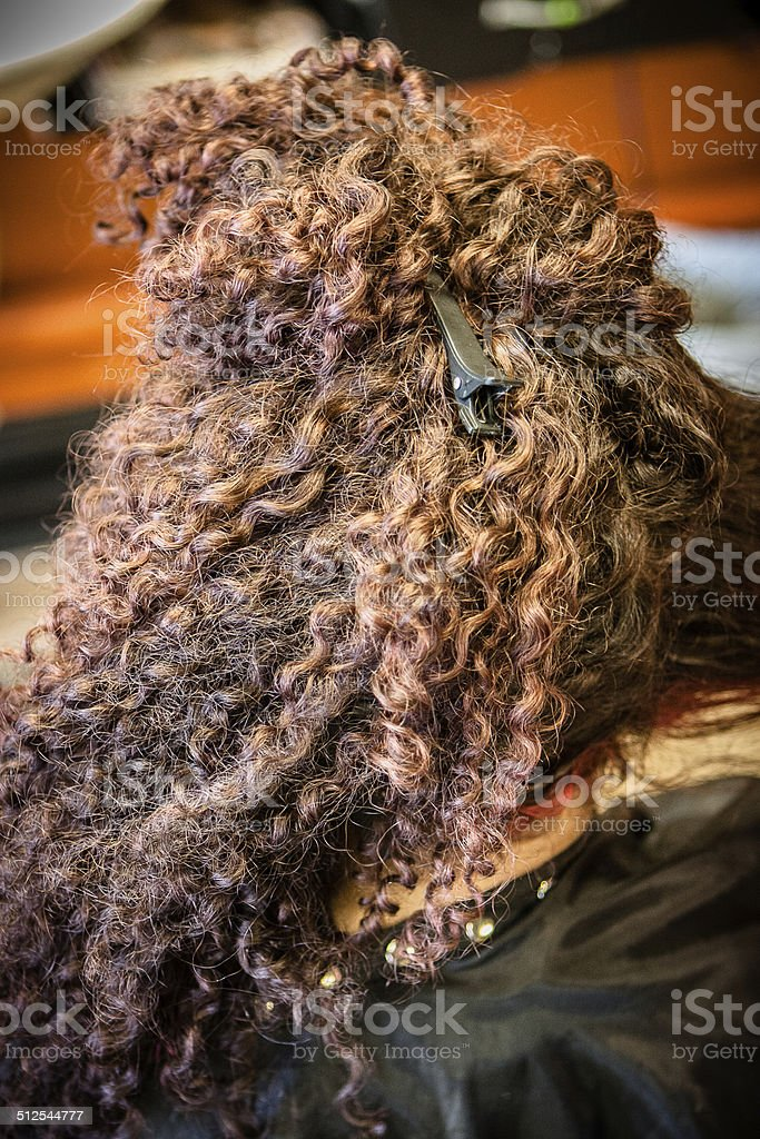 Customer with Curly Hair in Salon stock photo