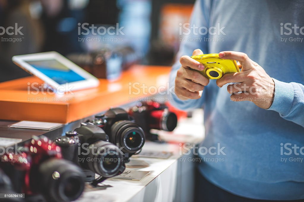 Customer with yellow camera stock photo