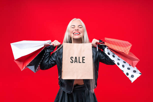 Customer woman isolated on red background. Black Friday and Sale concept stock photo