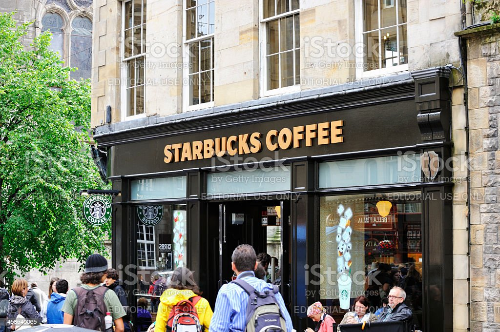 Customers and members of the public outside Starbucks Coffee royalty-free stock photo