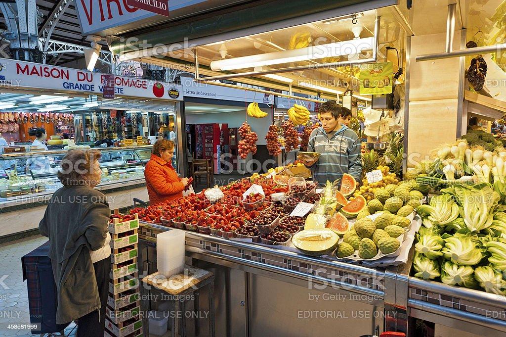 Customers at colourful market stall Valencia Spain royalty-free stock photo