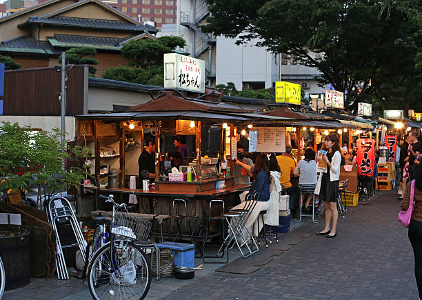 Customers at Yatai Food Stalls in Fukuoka, Kyushu, Japan stock photo