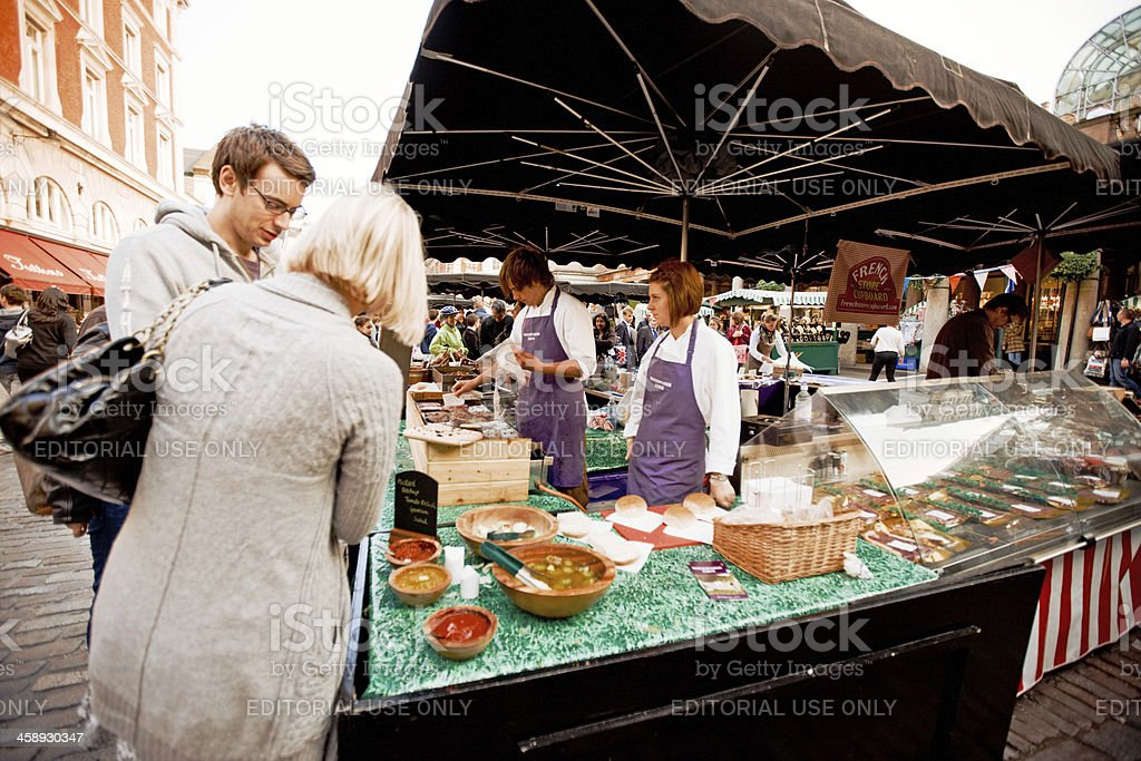 Customers  buying freshly made fast food, Covent Garden Market, royalty-free stock photo