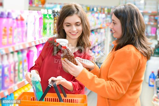 istock Customers choosing cleaning products in supermarket 638646916