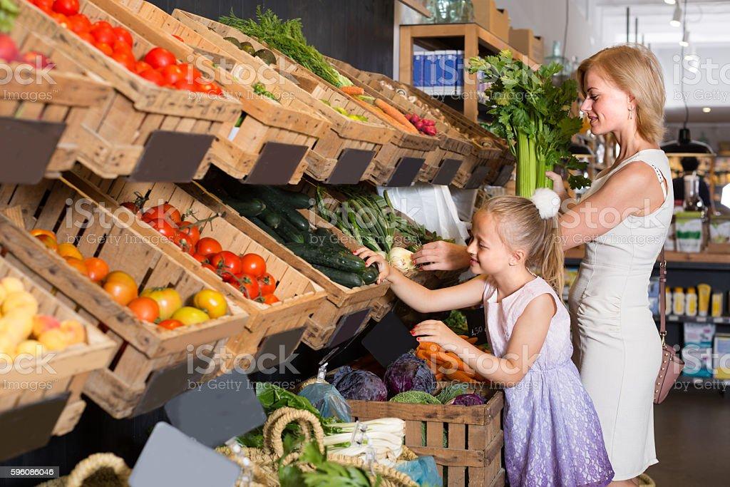 customers choosing vegetables royalty-free stock photo