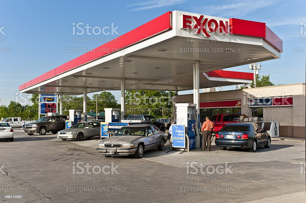 Customers Fuel Their Cars At An Exxon Gas Station Stock