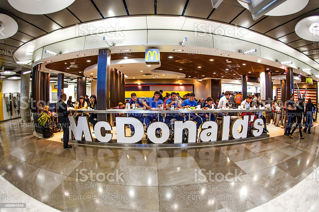 Customers having their meals at McDonald's Madrid airport stock photo