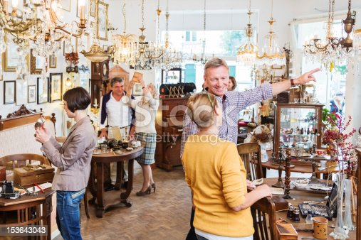 Many customers in an antique store in Berlin, Germany.