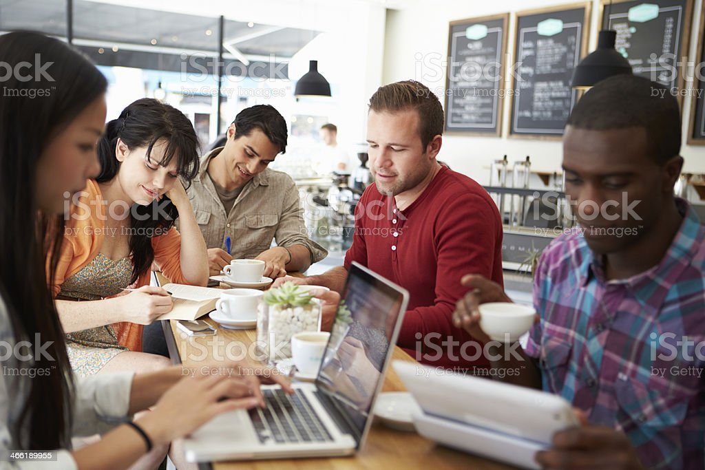 Customers In Busy Coffee Shop stock photo