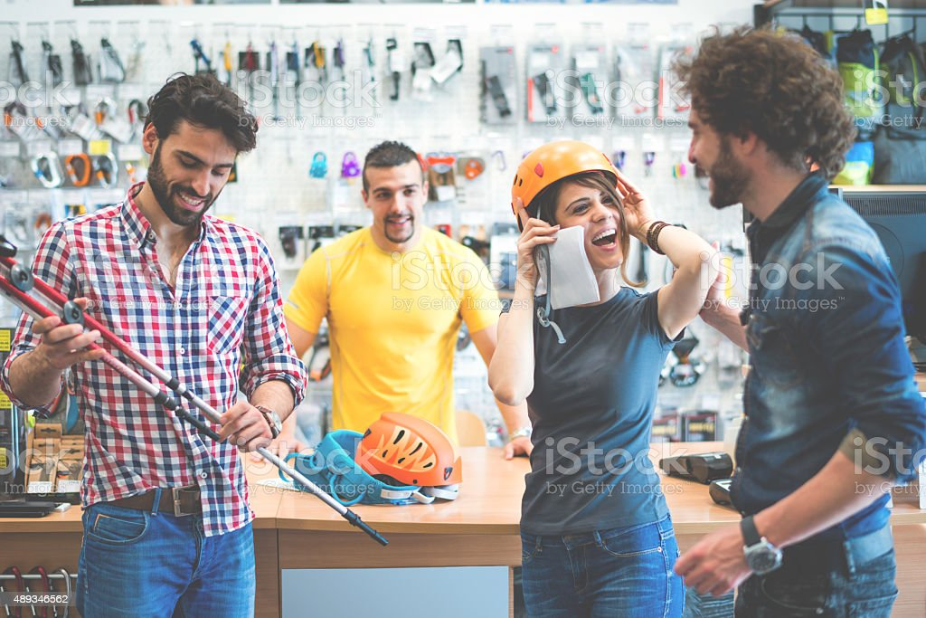 Customers in sports and outdoor equipment store stock photo