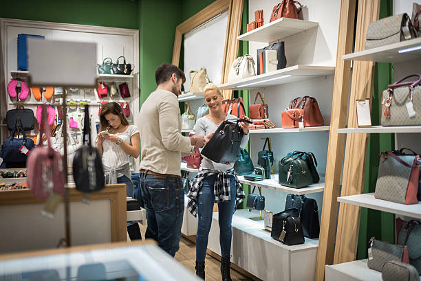 customers inside luggage store - leder portemonnaie herren stock-fotos und bilder