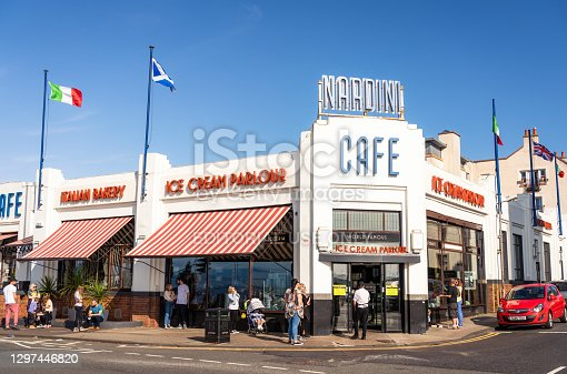Largs, Scotland - People outside the art deco exterior of Nardini Cafe in Largs, especially popular for their ice cream.