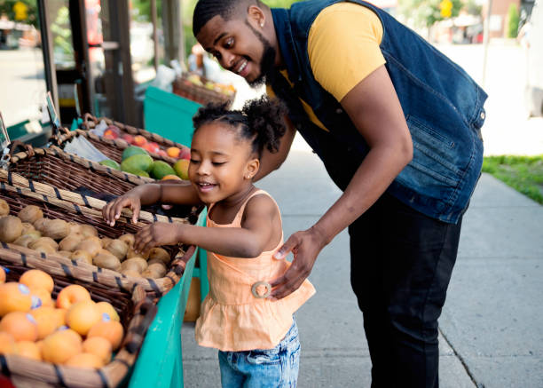 Customers outside zero waste oriented fruit and grocery store. stock photo