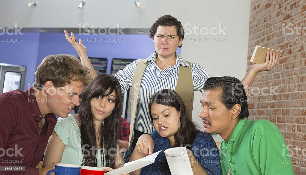 Customers Reading a Menu stock photo