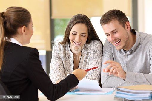 istock Customers ready to sign a contract at office 827951038