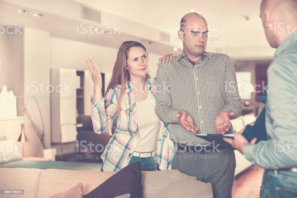 Customers revealing discontent with furniture seller - Royalty-free 25-29 Years Stock Photo