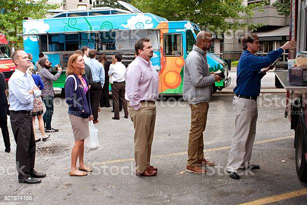 Customers stand in line to order meals from food trucks picture id527374155?b=1&k=6&m=527374155&s=612x612&h=s0vnaxzstlgjbm j98pxx6bmqc0vlge9olceq1cwqrg=