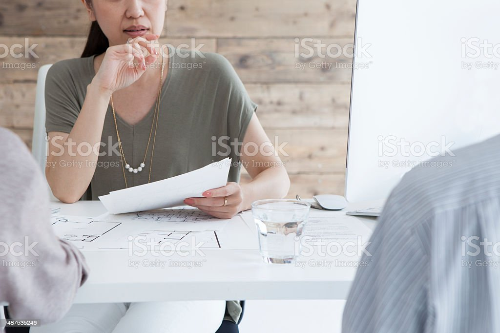 Customers to listen to the explanation from  real estate agent stock photo