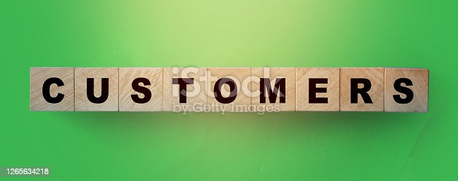 Customers word on wooden blockson green gradient background. B2C business marketing concept.