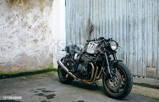 istock Customized motorcycle in front of garage door 1019946556