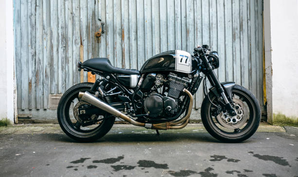customized motorcycle in front of garage door - moto imagens e fotografias de stock