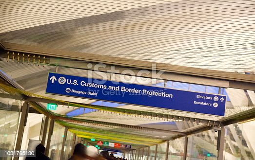 458464131istockphoto Customs and Baggage Claim sign at the airport 1031765130
