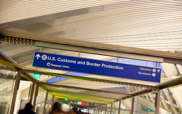 Customs and Baggage Claim sign at the airport LAX airport-  Customs and Baggage Claim sign close up view. border patrol stock pictures, royalty-free photos & images